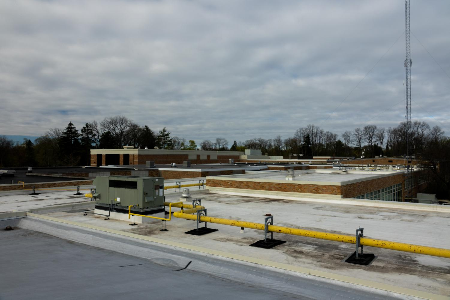 Accessed by a staircase that leads through the building and grounds areas, the roof of LHS has been largely updated since the building's original construction. The frontmost area pictured above was part of the original building plan, but the majority of the areas in the back were added on later, according to Mr. Stancil.