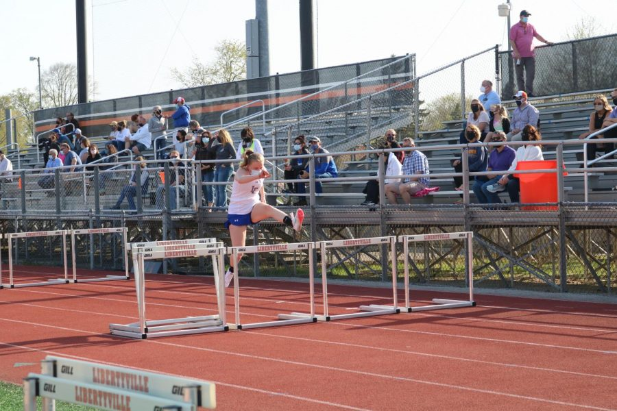 A Lake Forest track member practices her hurdles before her race.
