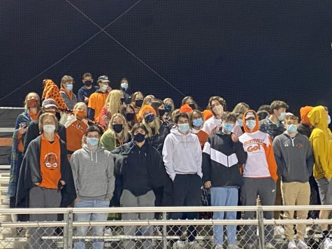 The student section is full of masked-up LHS seniors.