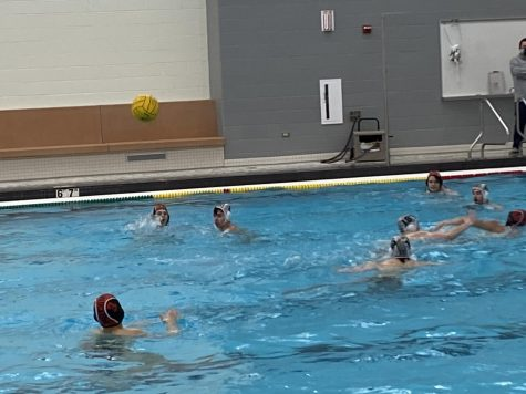 Sam Otto passes the ball back to an open Yaseen Tolba in the middle of the pool.