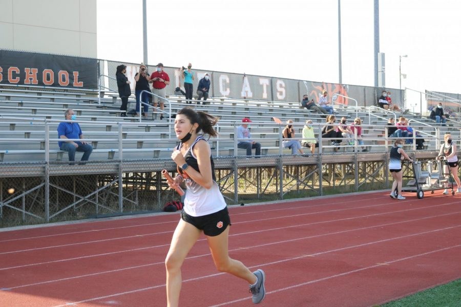 Senior Mia Vernasco finishes the last leg of the 4 x 800 meter relay, bringing the team into 1st place in that event.