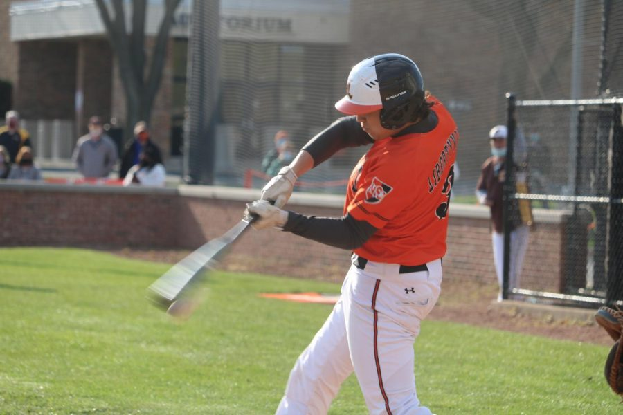 Junior Cole Collins hitting an RBI single in the 4th inning.
