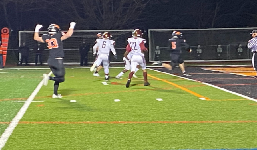 Aiden Nolan (33) celebrates as Blake Ellingson (5) runs across the goal line. Aiden Nolan (33) celebrates as Blake Ellingson (5) runs across the goal line.