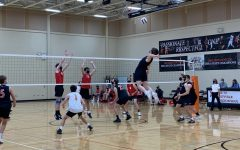 Oliver Sikora flies towards the net to spike the ball.