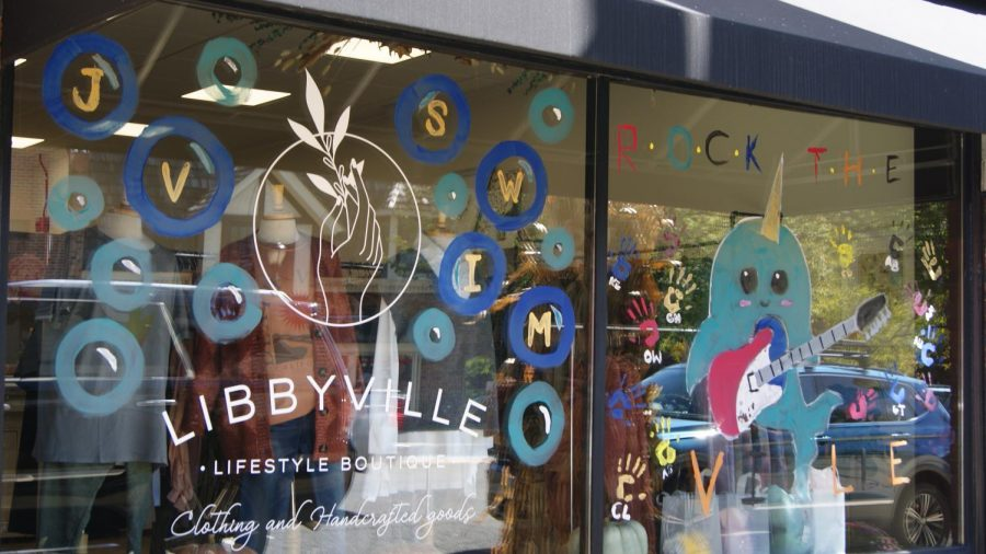 The girls jv swimming painted the Libbyville windows.