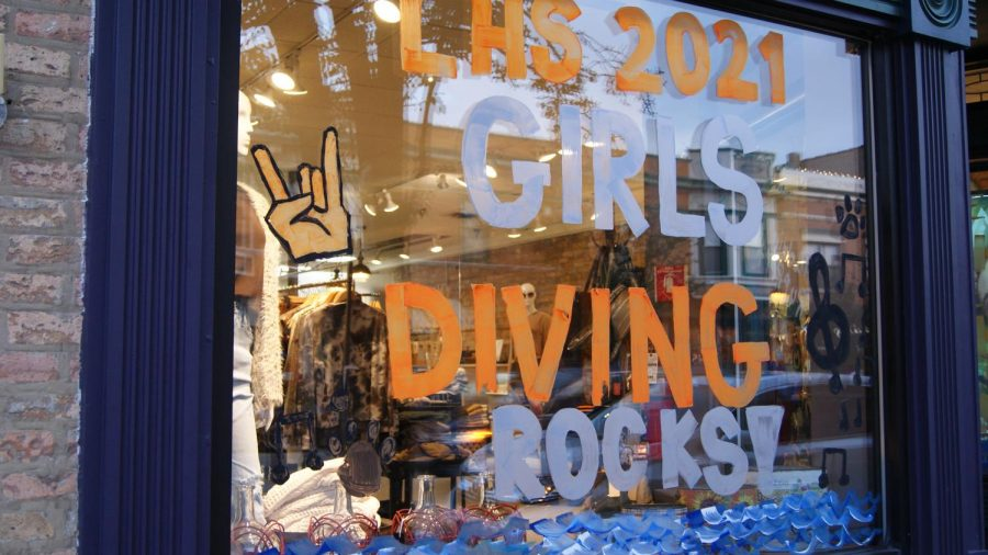 The girls diving windows combine diving and water elements with the homecoming rock theme.