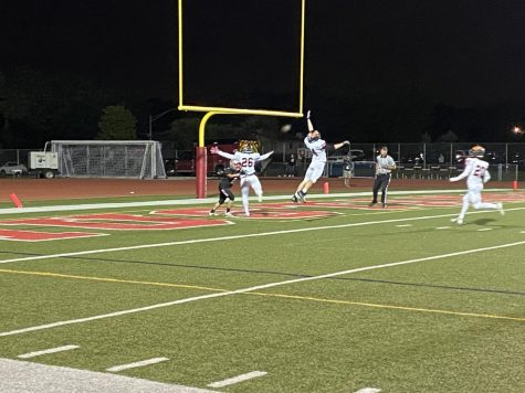 Dylan Holmes (26) and Connor Wolff (24) combine for an endzone pass-breakup.