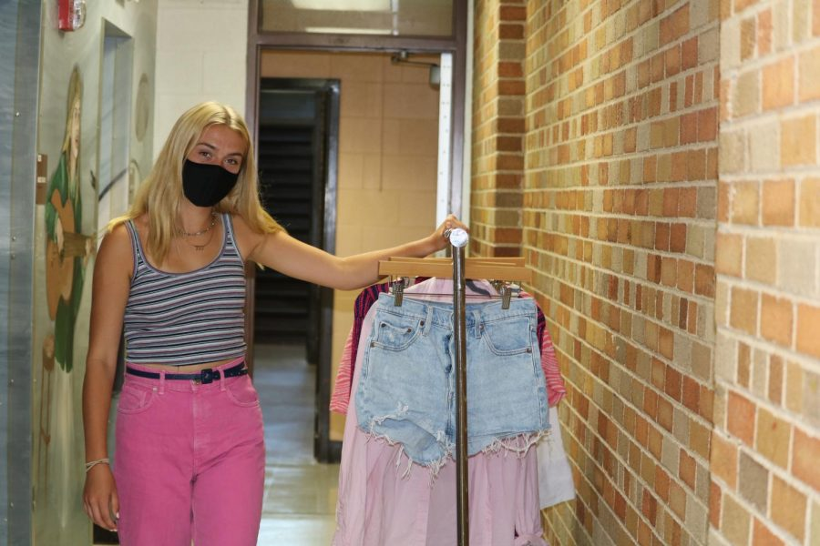 Kate Hopkins, senior, with some of her favorite closet essentials