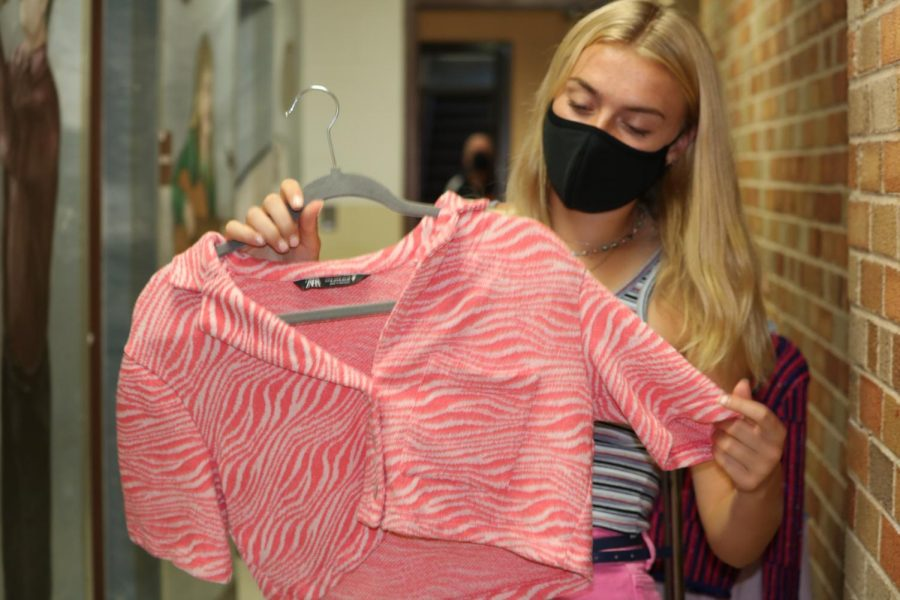 Hopkins with one of her favorite items, a pink striped button-up Zara top.
