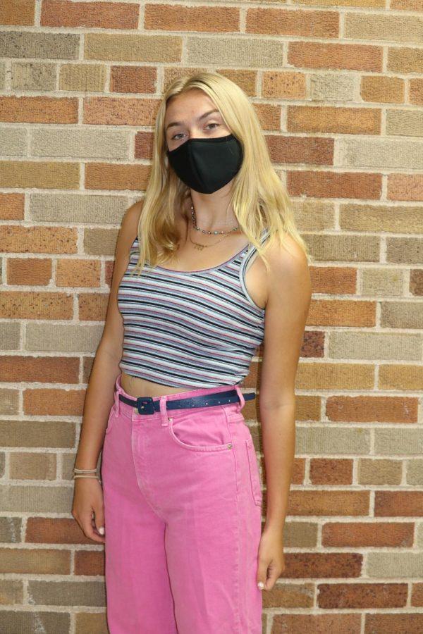 Kate Hopkins in a Brandy Melville tank, wide leg Zara pants, and a navy blue belt.