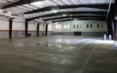 The currently dull, empty space of the Field House will soon be floored with the new Mondo surface.