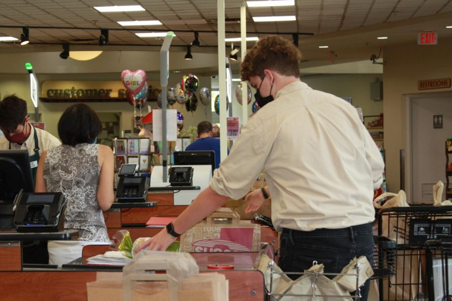 Peter Ericksen bags groceries at Sunset Foods during a four hour shift on a Saturday.
