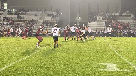 """Lucas Bruckner (72), Tyler Patterson (70), and the """"Mules"""" give Dickson a clean pocket."""
