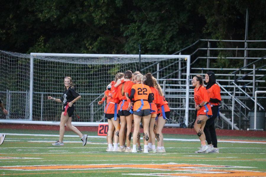 Team Orange huddles together, sharing tactics and strategy