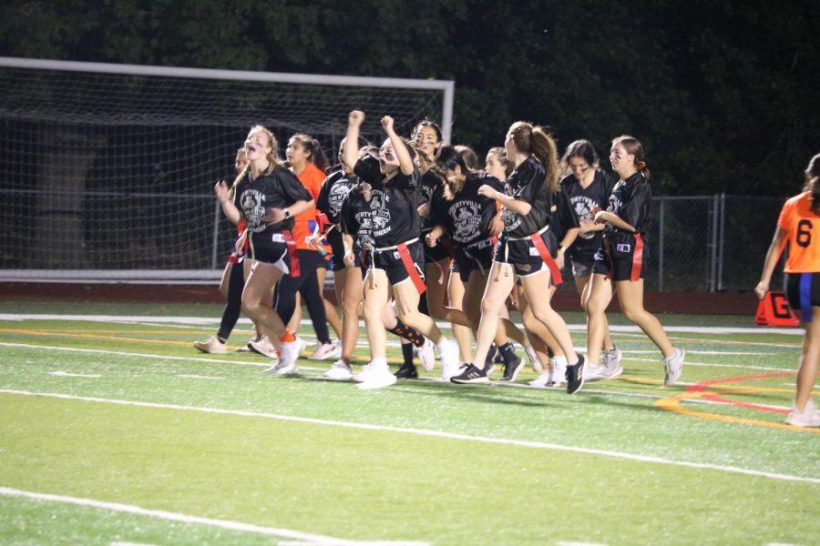 Team Black celebrates a touchdown scored by MeiLi Tompson.