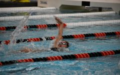 Sofija Tijunelis (10) charges to the finish in the 100 backstroke for a time of 59.05. Tijunelis headed off the record breaking 200 medley relay with backstroke earlier in the meet. (photo courtesy of Al Cowsky)